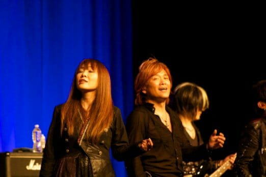 Masami Okui and Hironobu Kageyama. Okui-san is a prolific singer/songwriter with quite a few anime songs under her belt, including themes for Revolutionary Girl Utena and The Slayers.