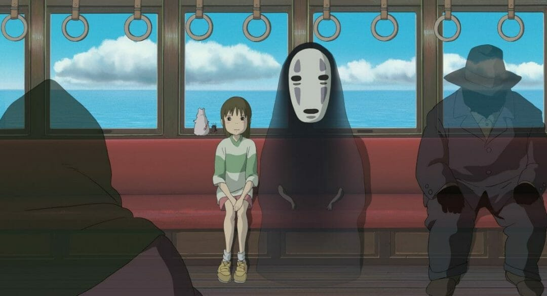 Spirited Away Still; Chihiro sits on a subway car with No Face