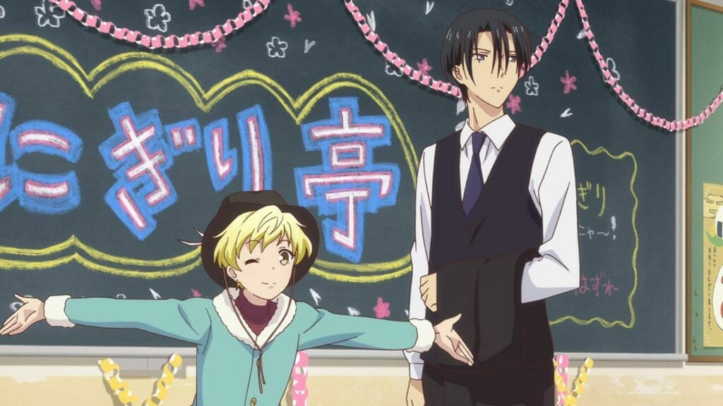 Fruits Basket (2019) Anime Still - Momiji Soma and Hatori Soma stand in front of a blackboard