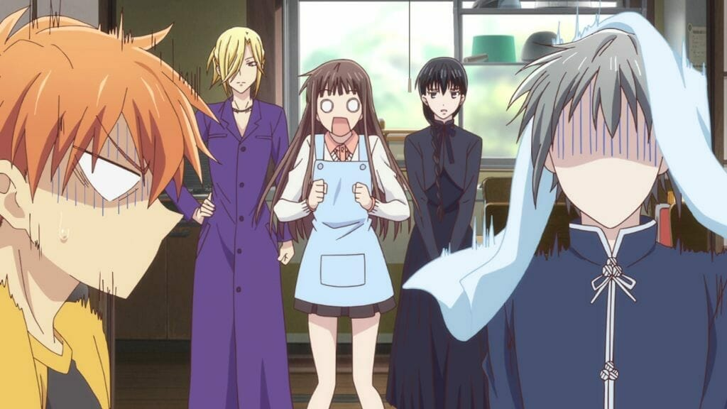 Fruits Basket (2019) Anime Still - Yuki Soma, Kyo Soma, and Tohru Honda stand in shock. Arisa Uotani and Saki Hanajima are in the background with nonplussed expressions.