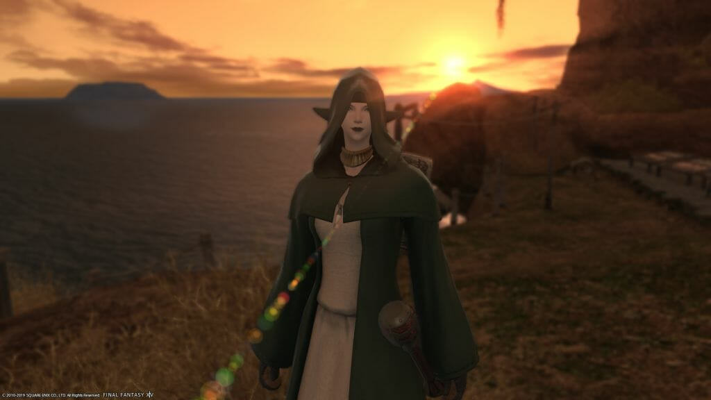 Skye Graneterre, a Duskwight Elezen, poses at sunset at Crescent Cove in Final Fantasy XIV