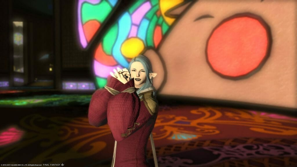 Skye Graneterre, a Duskwight Elezen, poses in the Gold Saucer in Final Fantasy XIV