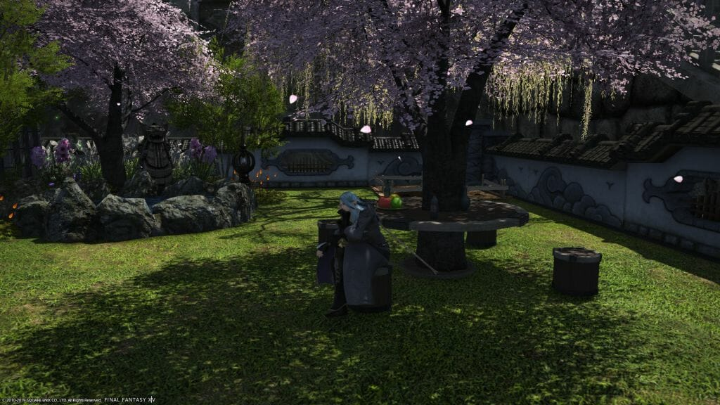 Skye Graneterre, a Duskwight Elezen, sits in the front yard of a Shirogane residence in Final Fantasy XIV