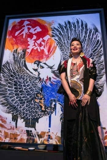 Japan Night 2019 - Sisyu Stands in front of a calligraphy work
