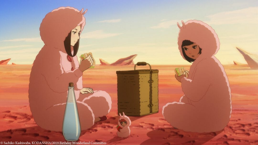 Two women, clad in fluffy pink outfits, sit on a dusty pink plain. They're eating sandwiches with a red-haired pixie, who's also clad in a pink puffy outfit.