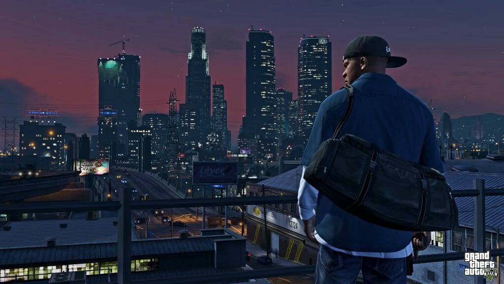 Grand Theft Auto V Still - A man stands on a building, which overlooks a bustling city. Windows glimmer with light along the skyline.