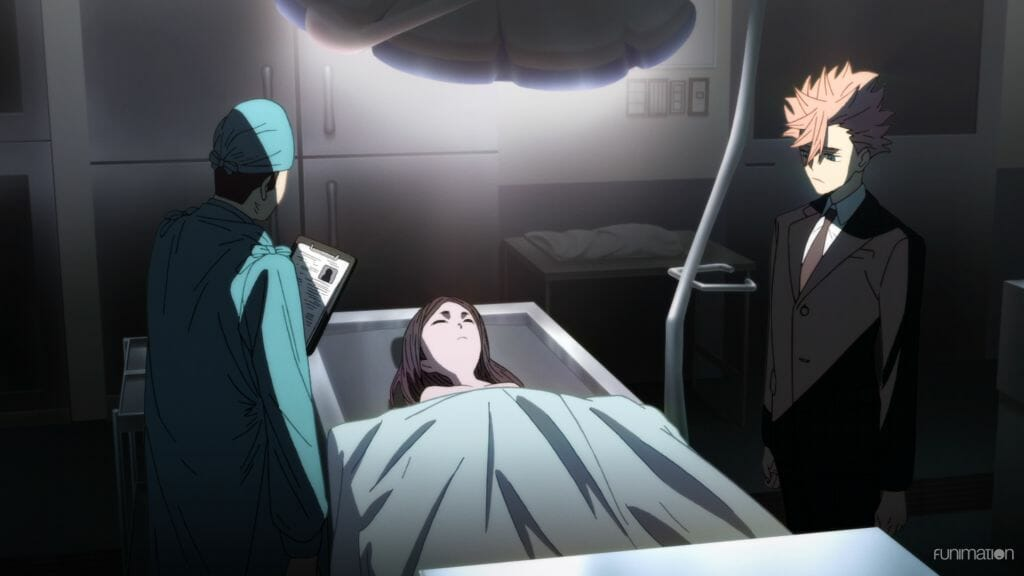 Id Invaded Episode 3 Still - Narihisago looks dispassionately at a cadaver. He stands across from a doctor, and is wearing a suit.