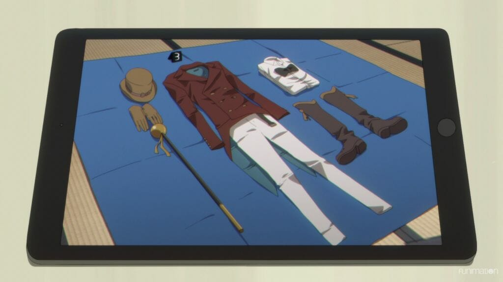 An array of clothes lain out on a blue blanket.