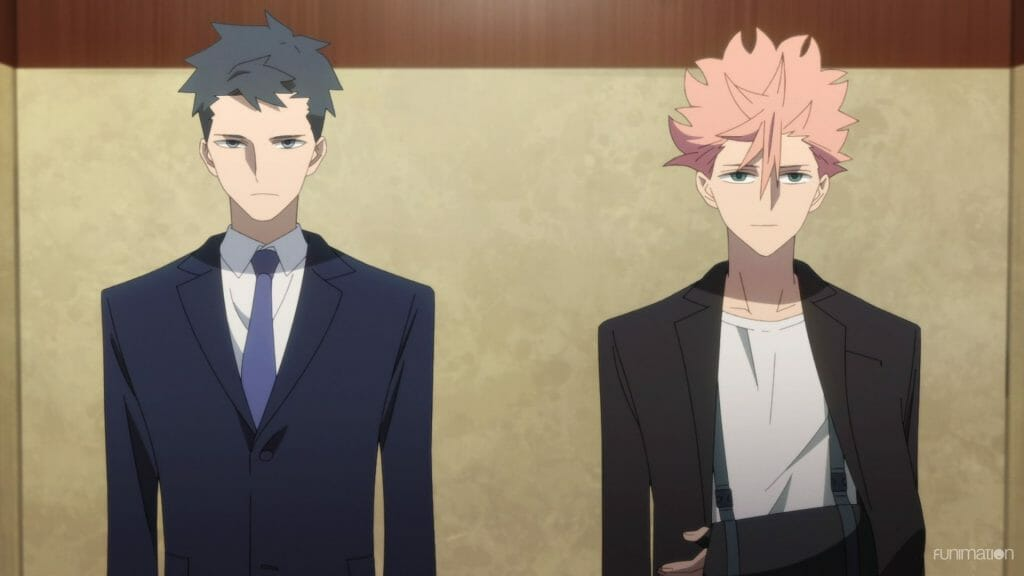 Id: Invaded Episode 10 Still - A dark-haired man in a suit and a pink-haired man in casual clothes and an arm sling stand side-by-side.