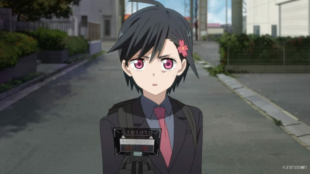 Id: Invaded Episode 10 Still - A woman with black hair and pink eyes wearing a business suit.