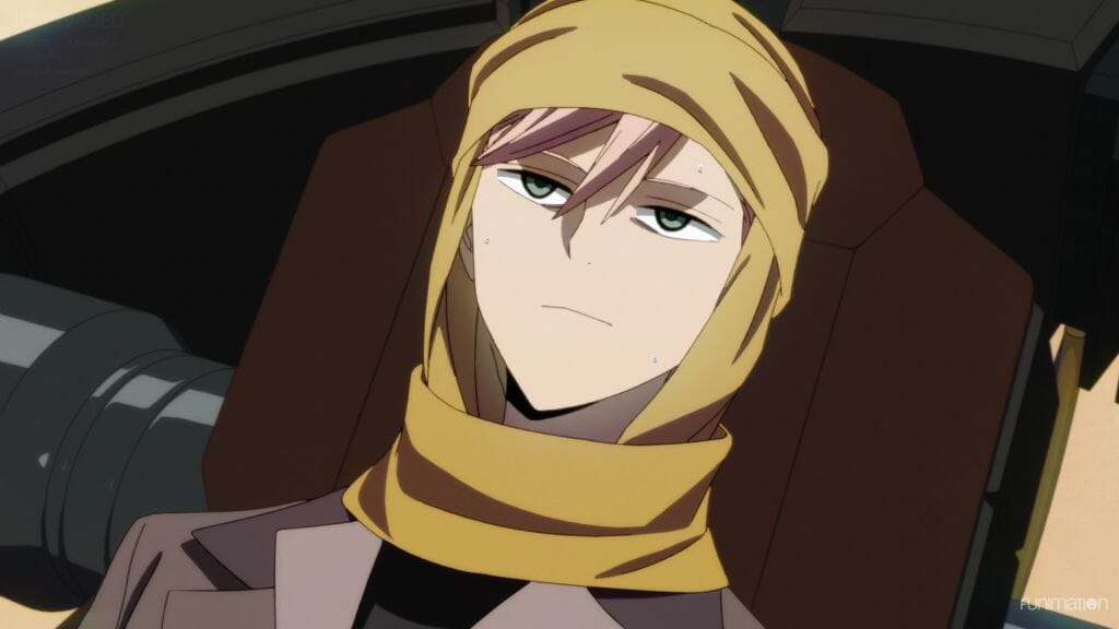 Id Invaded Episode 8 Still - A man with pink hair and a yellow head scarf lays on a brown chair