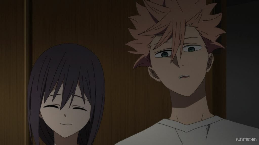 Id Invaded Episode 9 Still - a man with pink hair looks at the camera in confusion. A woman with dark hair smiles behind him.