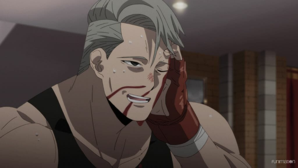 Id Invaded Episode 9 stilil - a man with grey hair and a black tank top stands, holding his head. Blood streams down his face.