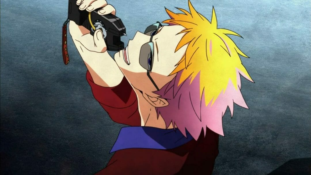 Hamatora Anime Still - A smiling blonde man wearing sunglasses and holding a taser.