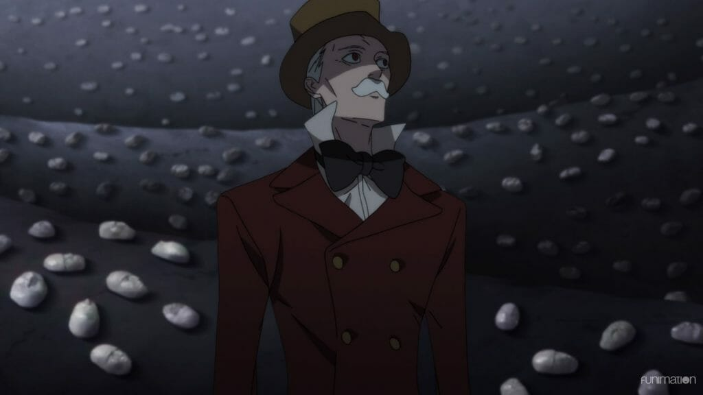 Id Invaded Episode 12 Still - a grey-haired man in a top hat and tuxedo wanders a grey landscape littered with masks.