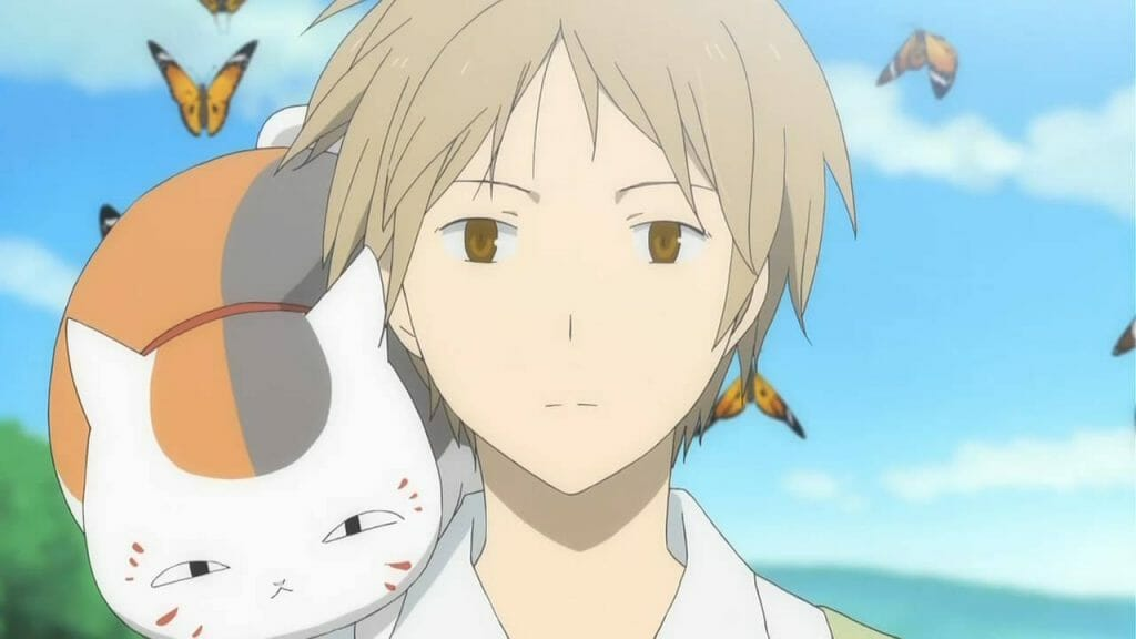 Natsume's Book of Friends Anime Still - A man with blonde hair stands with a tabby cat on his shoulder.