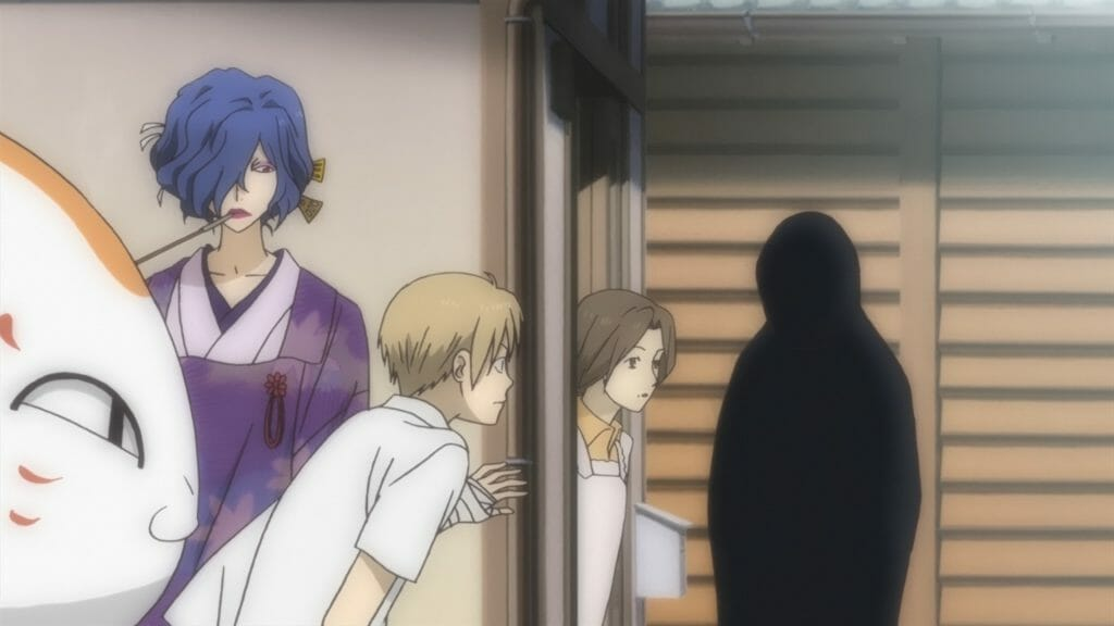 Natsume's Book of Friends Anime Still  - Ablonde man and a raven-haired woman peer on two people talking. A cat eyes mischievously from the left side of the frame.