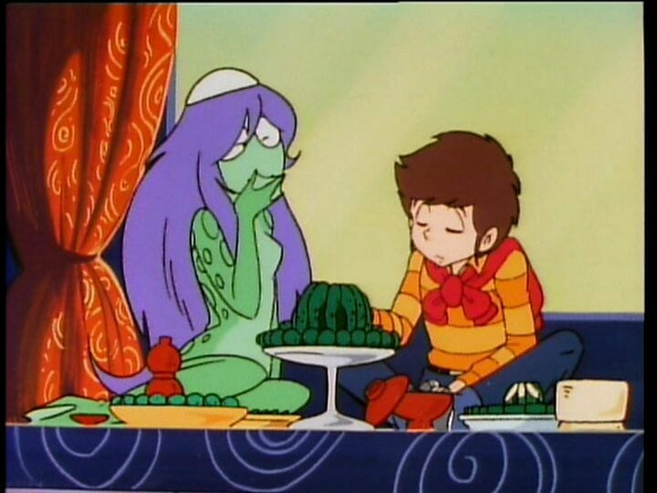Urusei Yatsura Anime Still - A brown-haired man sits with a defeated expression, as a scaly green woman smiles cheerfully. A plate of cucumbers sits between them.