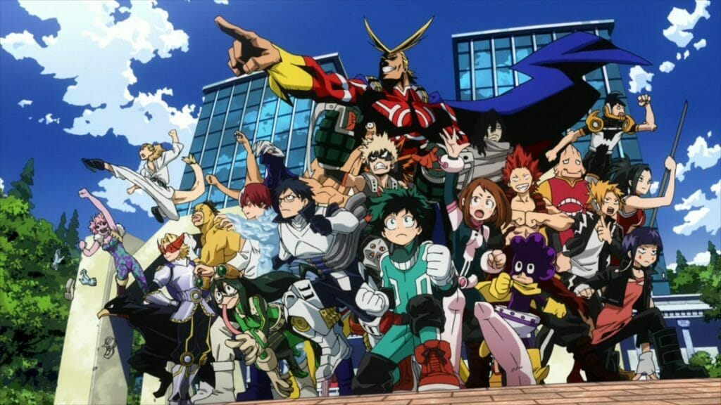 My Hero Academia anime still - A blonde superhero points toward the camera, as more than a dozen children in costumes set their sights ahead.