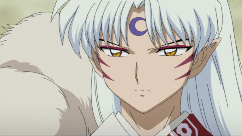 InuYasha anime still - a white-haired man with face markings.