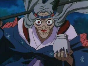 InuYasha anime still - an old woman clad in a kimono, wearing a headband.