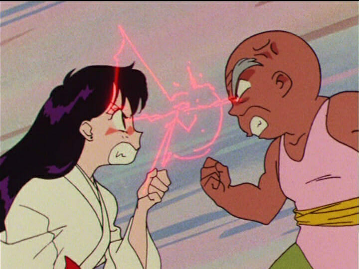 Sailor Moon anime still - A black-haired girl fights with a small, bald old man.