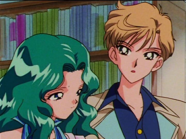Sailor Moon anime still - a green-haired woman stands with a brown-haired woman.