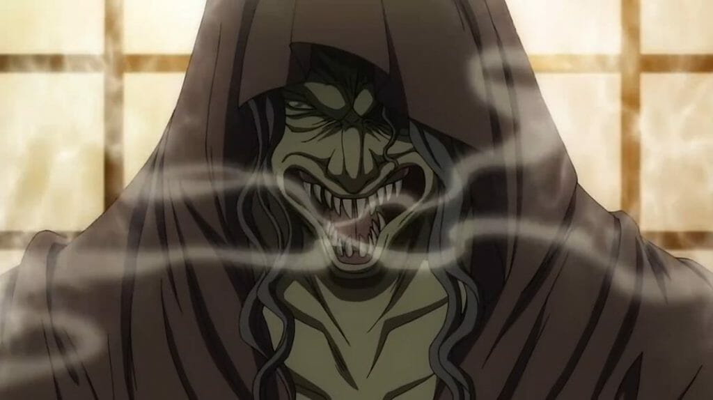 A monstrous hooded man grins evilly as smoke belches forth from his mouth.