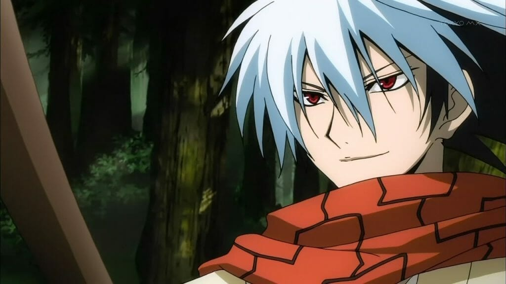 A man with white hair and a red scarf smirks smugly at the camera