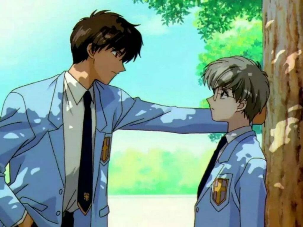 A brown-haired teenage boy does a kabedon to a smaller blonde teenage boy.