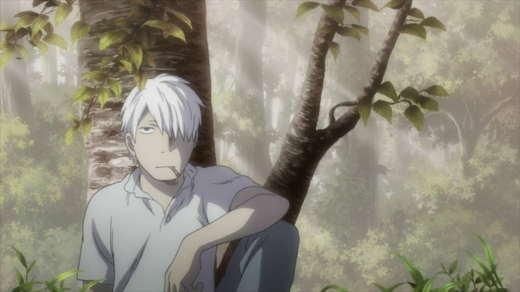 A white-haired man smokes a cigarette as he sits against a tree.