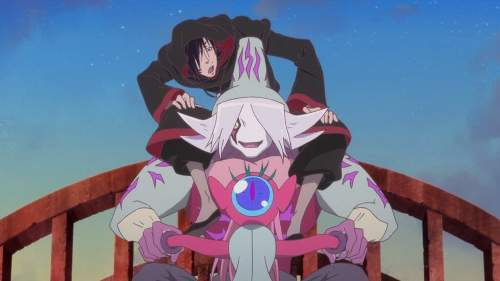 A black-haired man in a cloak sits on the shoulders of an alien who is riding a motorcycle across a wooden bridge.