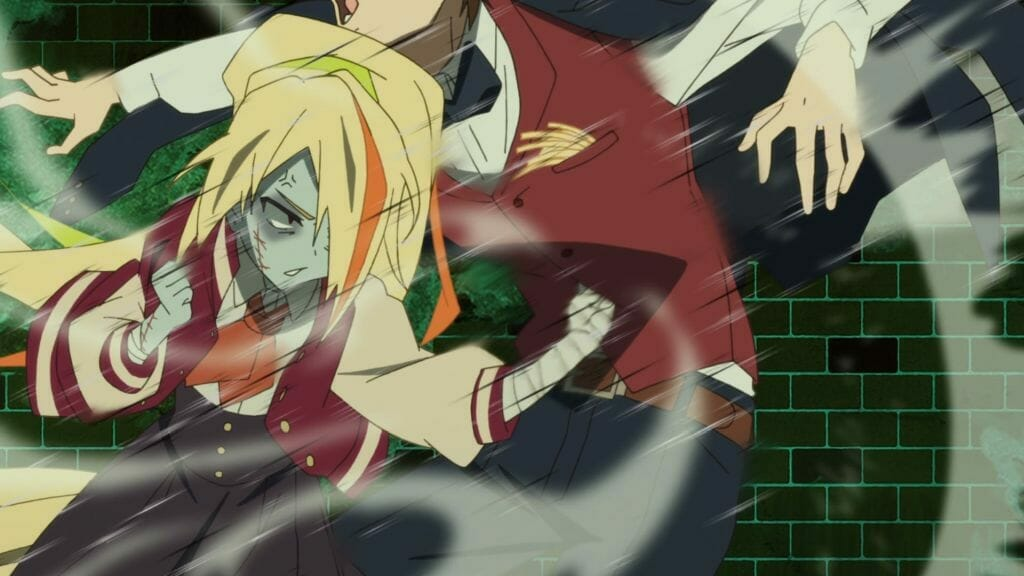 A blonde zombie girl lunges forward and punches a man in a suit in the dick.