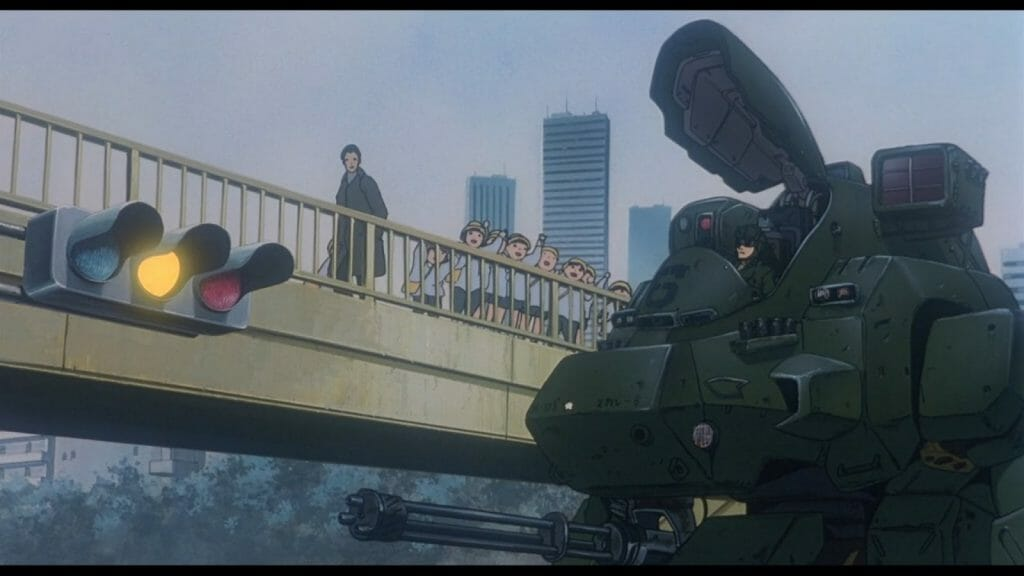 Still from Patlabor 2, which features a class of grade schoolers who watch a massive mobile tank.