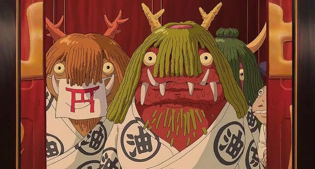 Still from Spirited Away which depicts frumpy monsters with green hair, horns, sharp teeth, and beady eyes