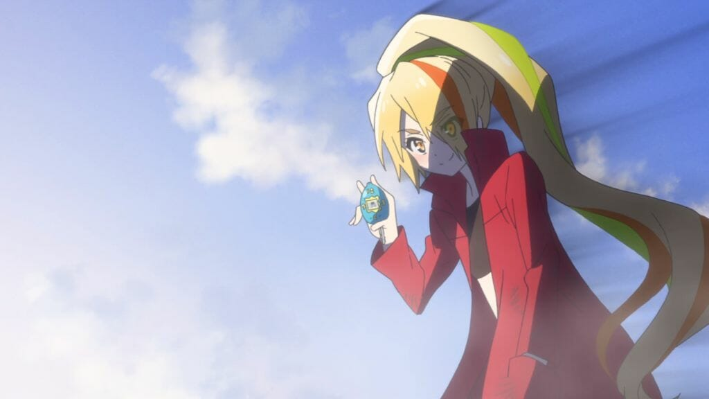 Still from Zombie Land Saga Episode 9, which features Saki wearing a red coat. She smiles as she holds up a Tamagotchi.