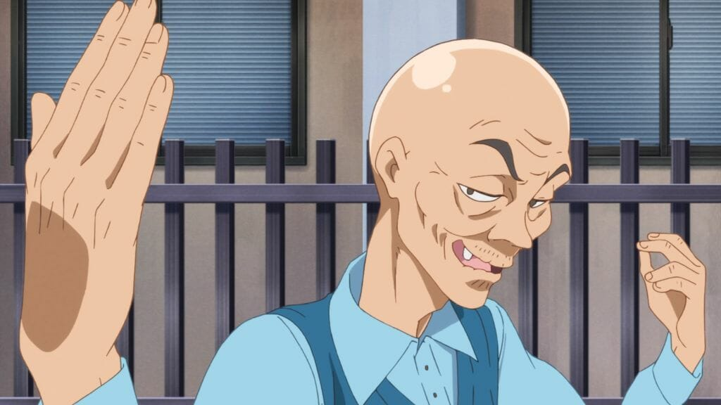 """Still from Zombie Land Saga Episode 9, which features a bald old man giving a """"just bring it"""" hand gesture."""
