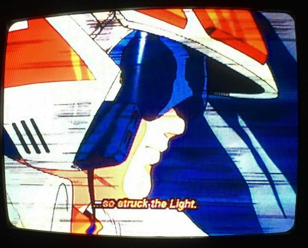 Photograph of an analog tub TV playing Super Dimension Fortress Macross