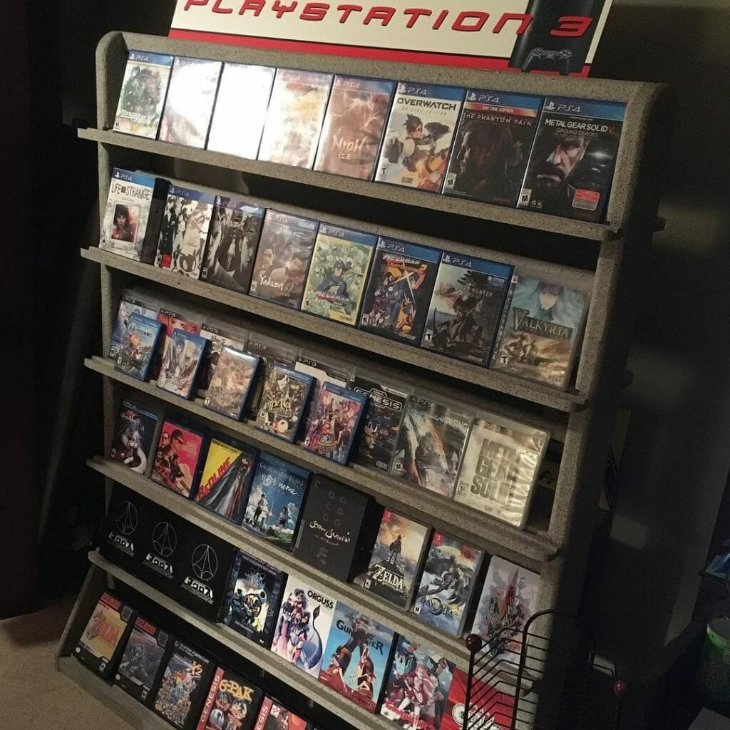 Photograph of video games arranged on a PlayStation 3 retail shelving unit.