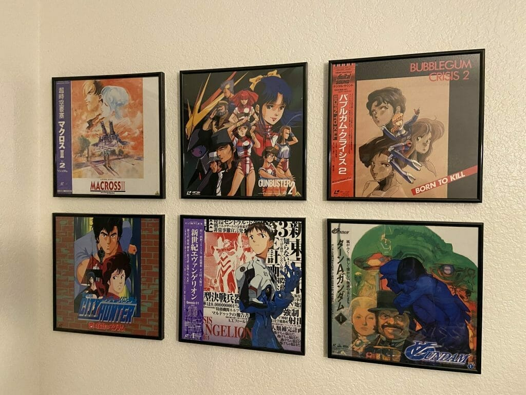 Photograph of framed Laserdiscs hung on a wall.