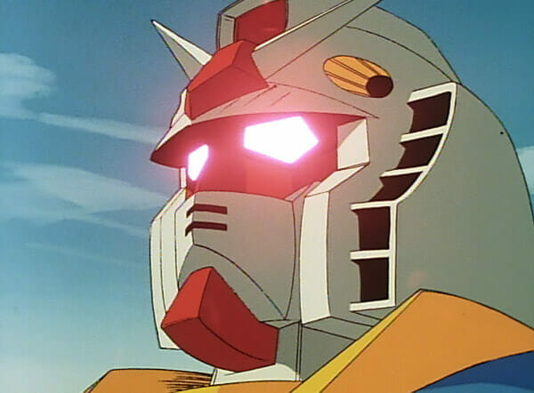 The head of a Gundam Mobile Suit, with glowing red eyes.