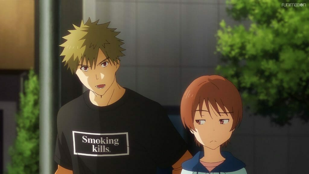 """Screenshot from Ikebukuro West Gate Park that features a blonde man wearing a black shirt that says """"Smoking Kills."""" A young woman with brown hair looks at him skeptically."""
