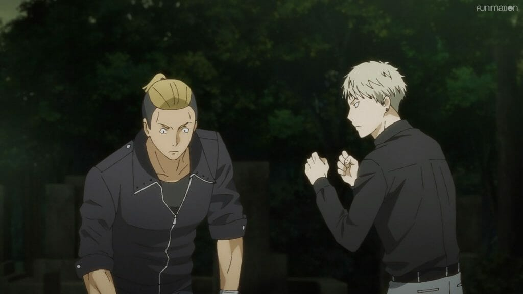 A blonde man in a black shirt punches a man in a black leather jacket.