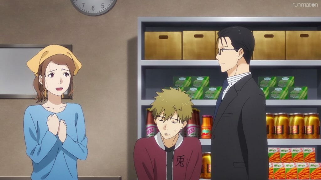Ikebukuro West Gate Park Episode 5 that depicts Makoto's mother talking with a dark-haired man in a suit. Makoto looks on, curious.