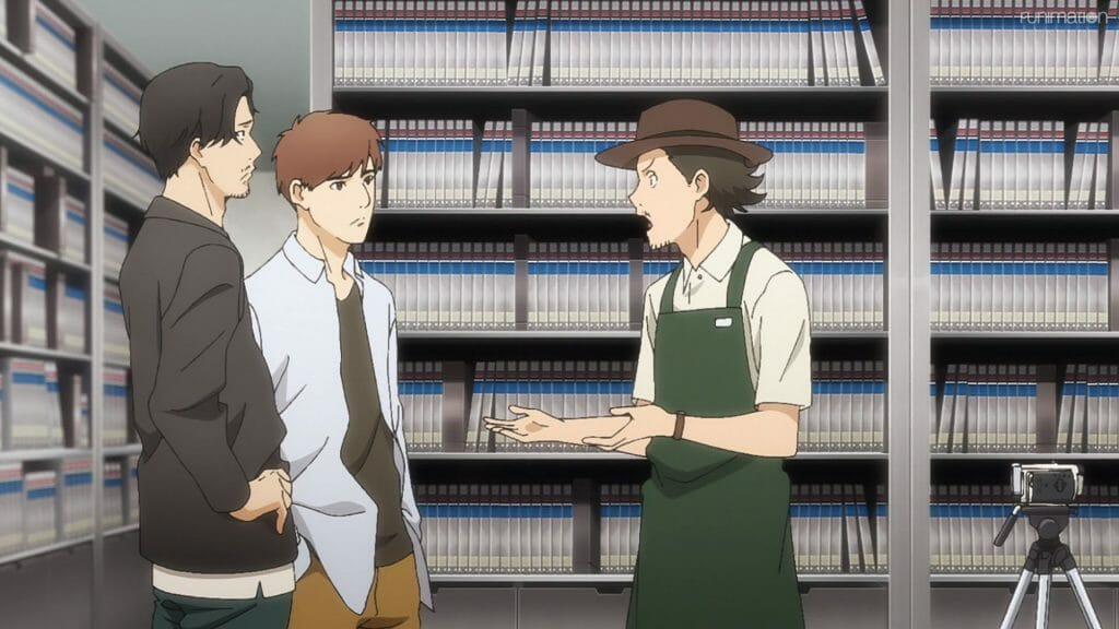 Still from Ikebukuro West Gate Park that depicts a man in a pork-pie hat and an apron who is lecturing two casually-dressed men.
