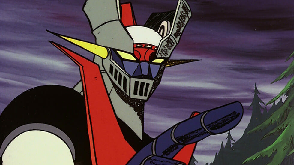 Headshot of Mazinger Z: a giant grey robot with yellow eyes and red accents