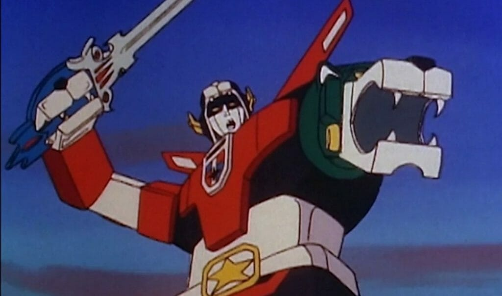 Upper body shot of Voltron: a giant multicolored robot holding a sword.