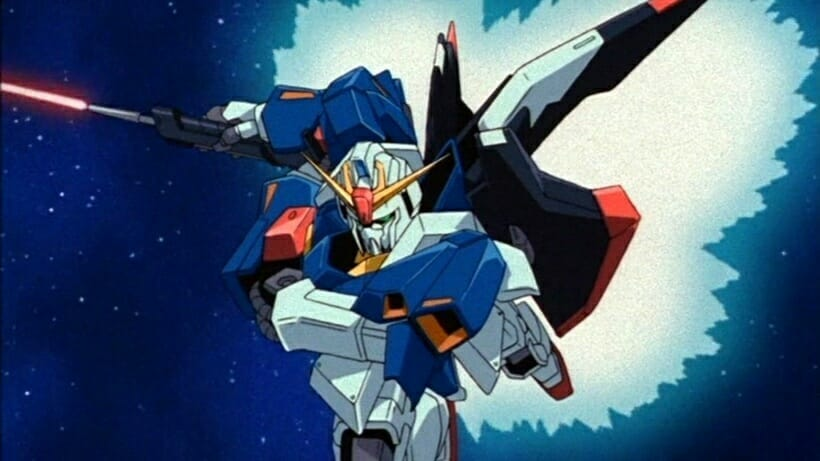 Still from Mobile Suit Zeta Gundam, which features a giant robot rocketing forth as it holds a laser sword.
