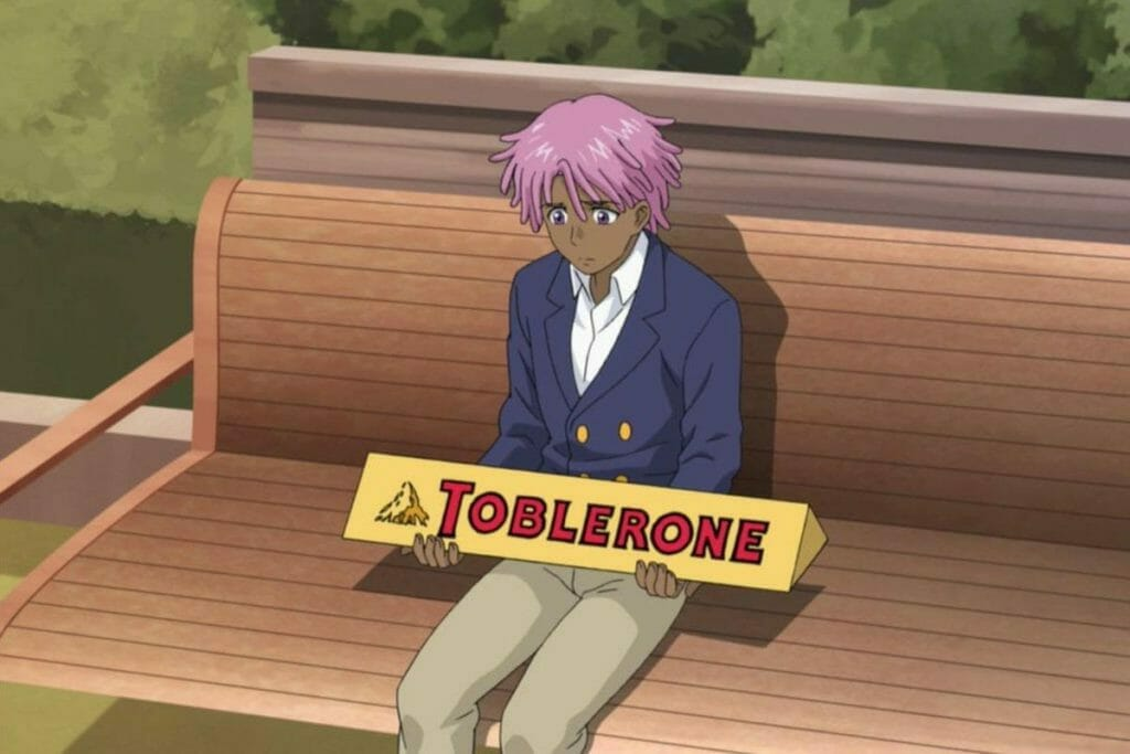 Kaz Kaan from Neo Yokio, sitting on a park bench with his famous Big Toblerone