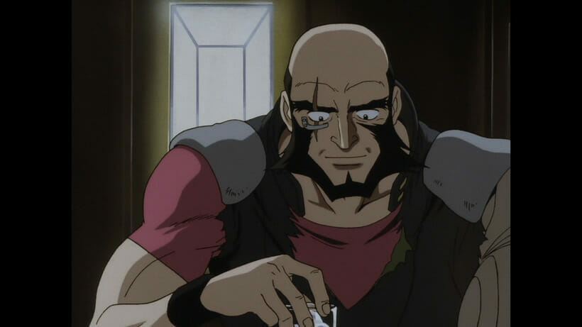 Jet Black from Cowboy Bebop smiles as he sits with a highball glass in his hand.